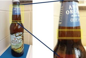 "For an individual bottle (please use extreme care): locate the inkjet code printed directly on the glass, on the ""shoulder"" of the bottle just below the neck label.  If that code falls within the ranges of C16650001 through C16650530 OR C18050001 through C18050415, that cider may have been impacted. (PRNewsFoto/Angry Orchard)"